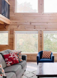 cabin living room with couch, armchair, and coffee table