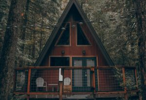 exterior of cabin in the woods