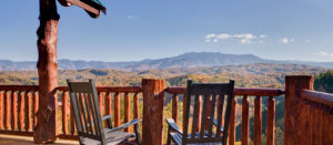 cabin patio with 2 chairs and a beautiful view of smoky mountains