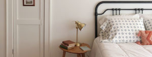 bedroom with lamp on desk